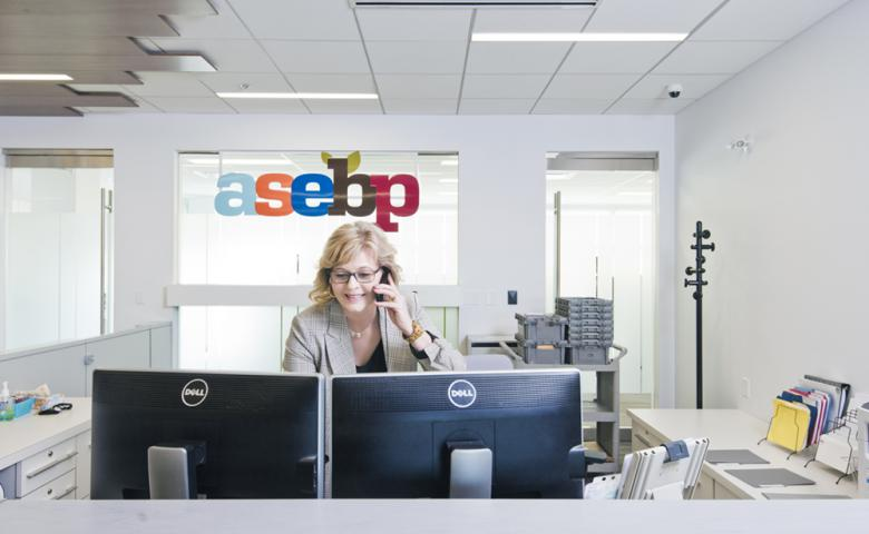 ASEBP Receptionist Answering a Call