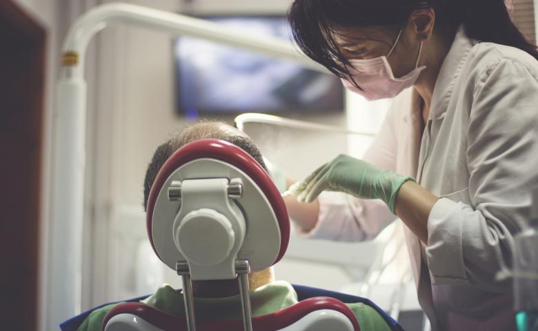 Female dentist performing checkup